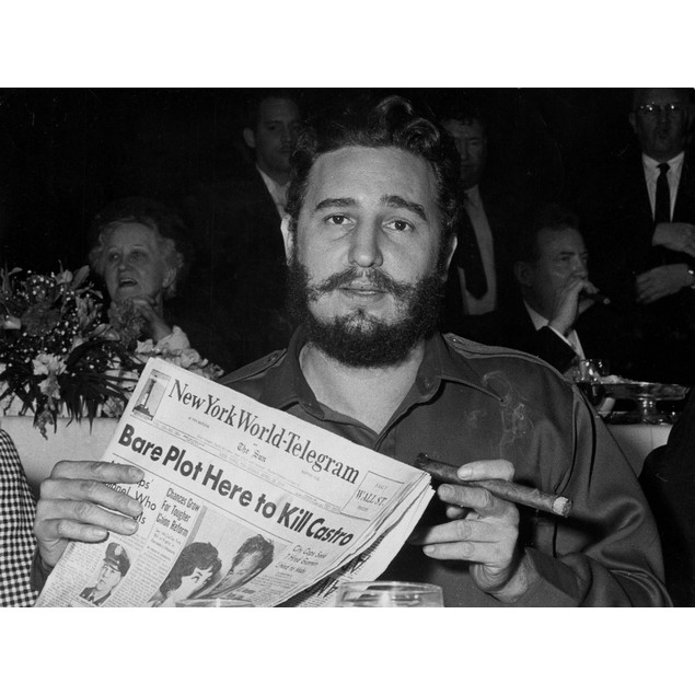 Fidel Castro holding a newspaper Poster