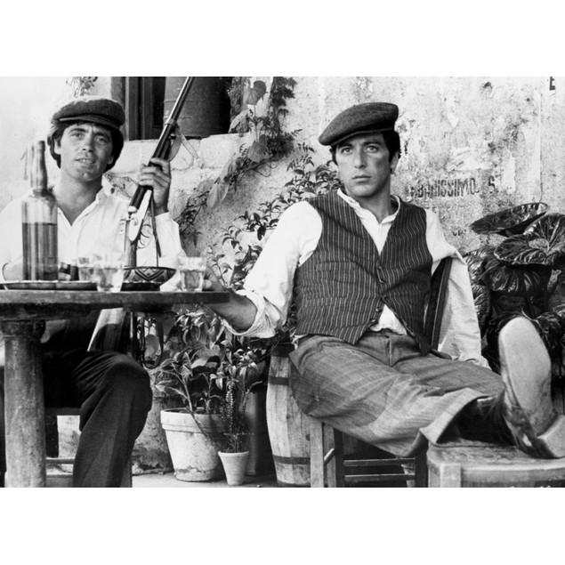 Marlon Brando Seated with a Man Holding a Gun Poster