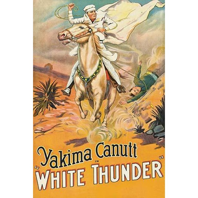 White dressed and caped rider holds a lasso and lasso's a cowboy pulled fro