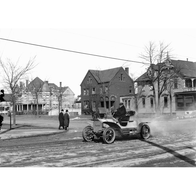 Automobile, C1905. /Nman Driving An Automobile Through An American Town. Ph
