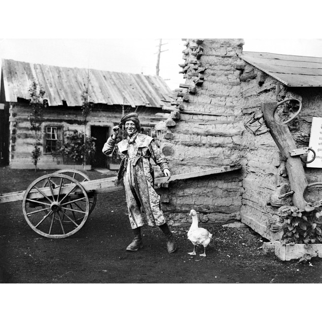 Entertainer, 1901. /Nan Entertainer And A Goose In A Display Of Log Cabins