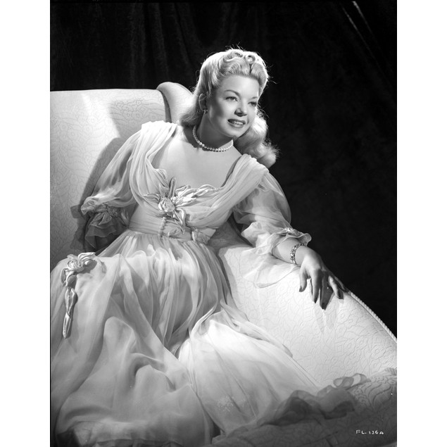 Francis Langford Reclining in Dress with Black Background Poster