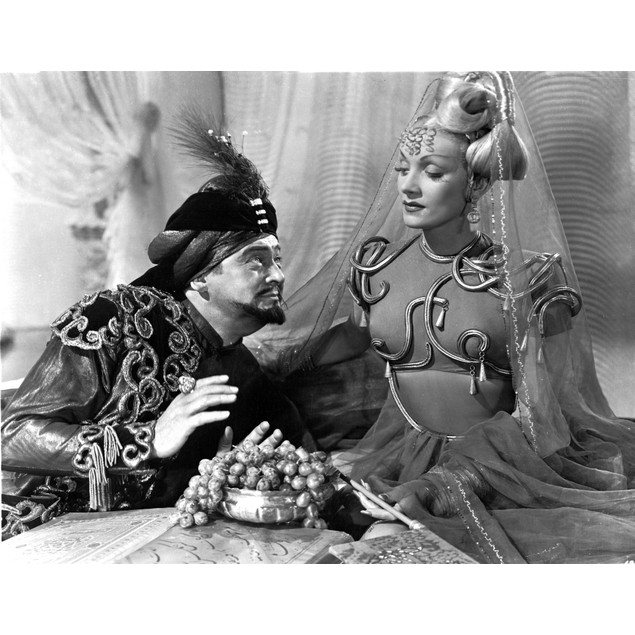 Marlene Dietrich sitting with Man in Detailed Dress with Veil Poster