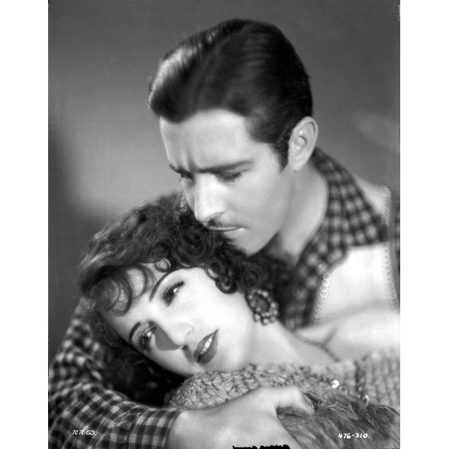 Bebe Daniels Lying on the Man's Arms in Knitted Dress Poster