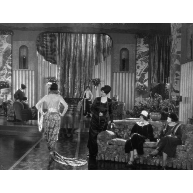 Silent Film Still: Fashion. /Na Scene From 'Nellie, The Beautiful Cloak Mod