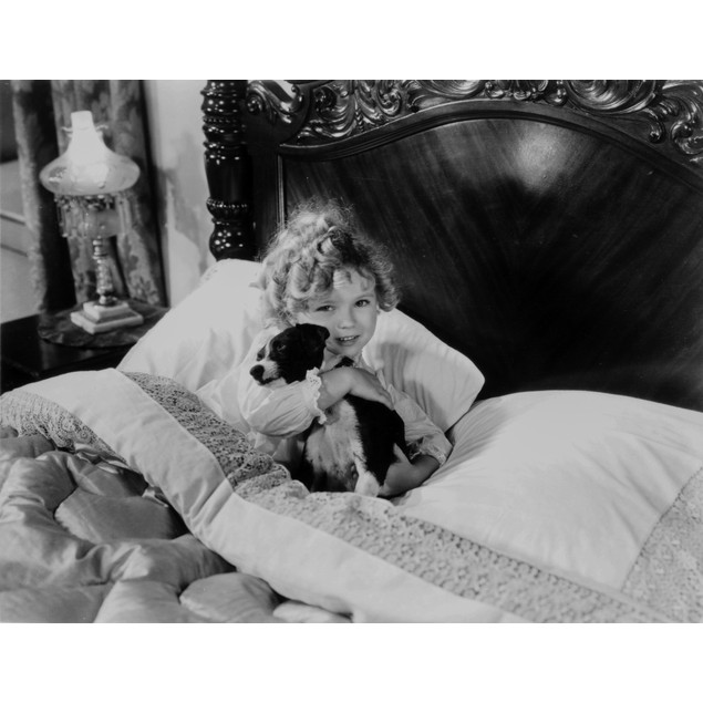 Shirley Temple hugging a Dog in Pajama Poster