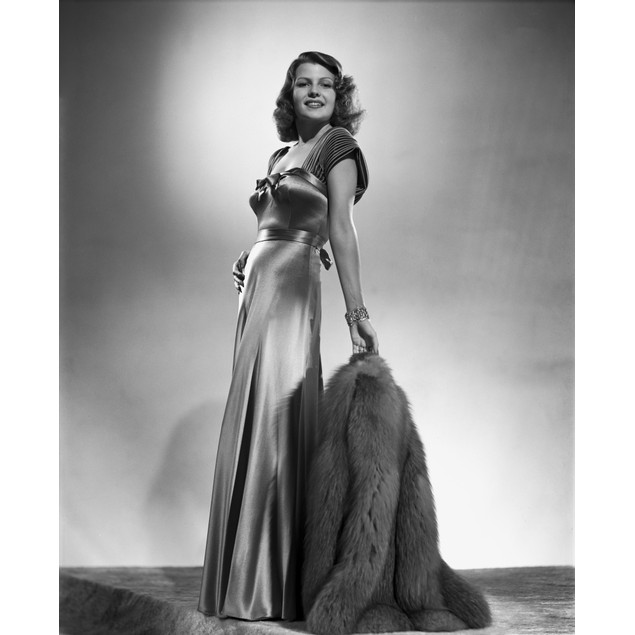 Rita Hayworth Posed in a Shiny Gown Poster