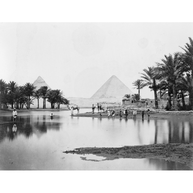 Egypt: Pyramids. /Na View Of The Pyramids With People Wading In A Lake In T