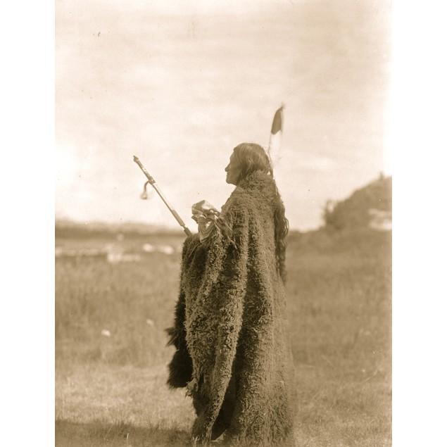 Saliva, an Oglala Sioux priest, dressed for the Hu Kalowa Pi ceremony. Post
