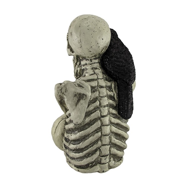 Skeleton And Raven Statue With Light Up Eyes 13.5 Statues