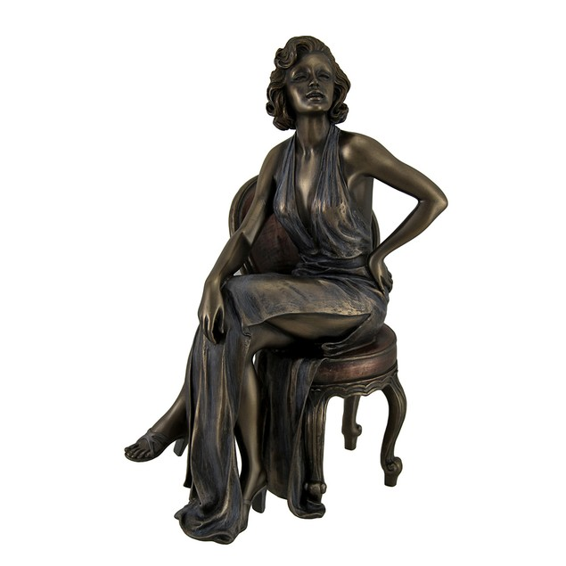 Retro Pin Up Girl In Daring Dress Posing On Chair Statues