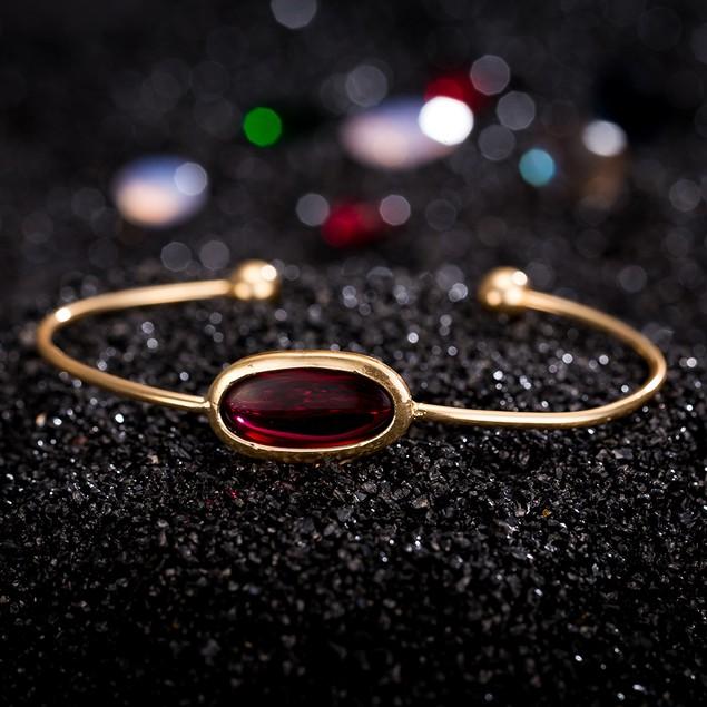 Gold Plated Ruby Center Gem Open Ended Bangle